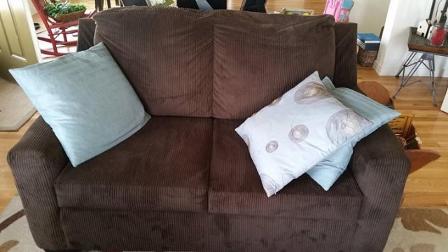 Brown sofa and love seat set